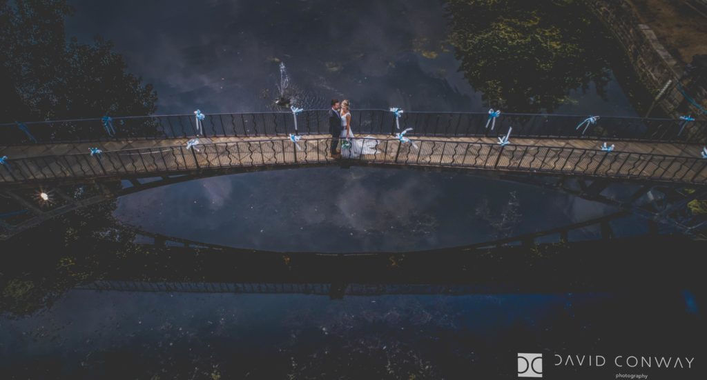 Drone shot of bride and groom from above on the bridge at Waterton park hotel, Walton, West Yorkshire