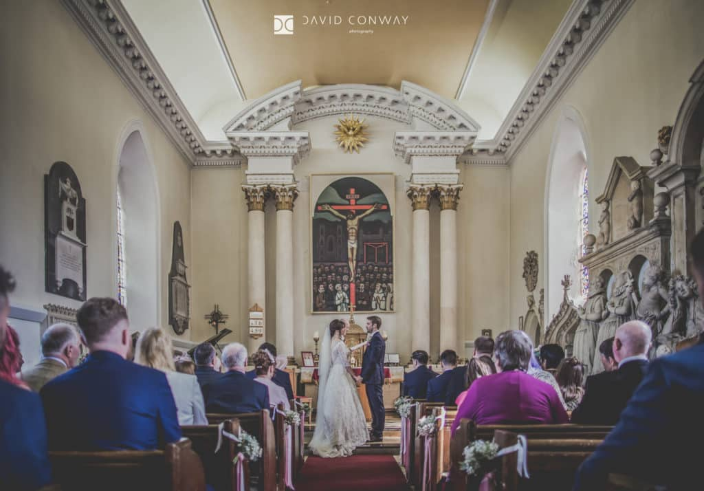 Bride and groom at the front of the church at hazlewood castle in West Yorkshire