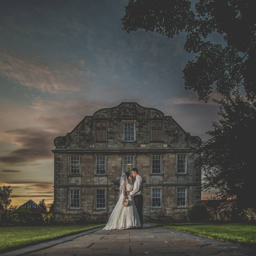 Bride and Groom at sunset infront of Hellaby Hall, West Yorkshire