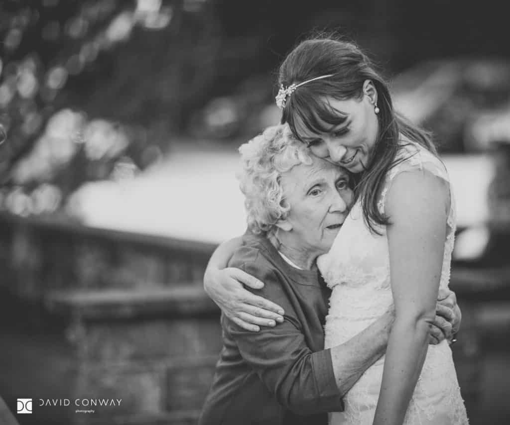 Bride hugging grandmother during the drinks reception at cubley hall in penistone, West Yorkshire