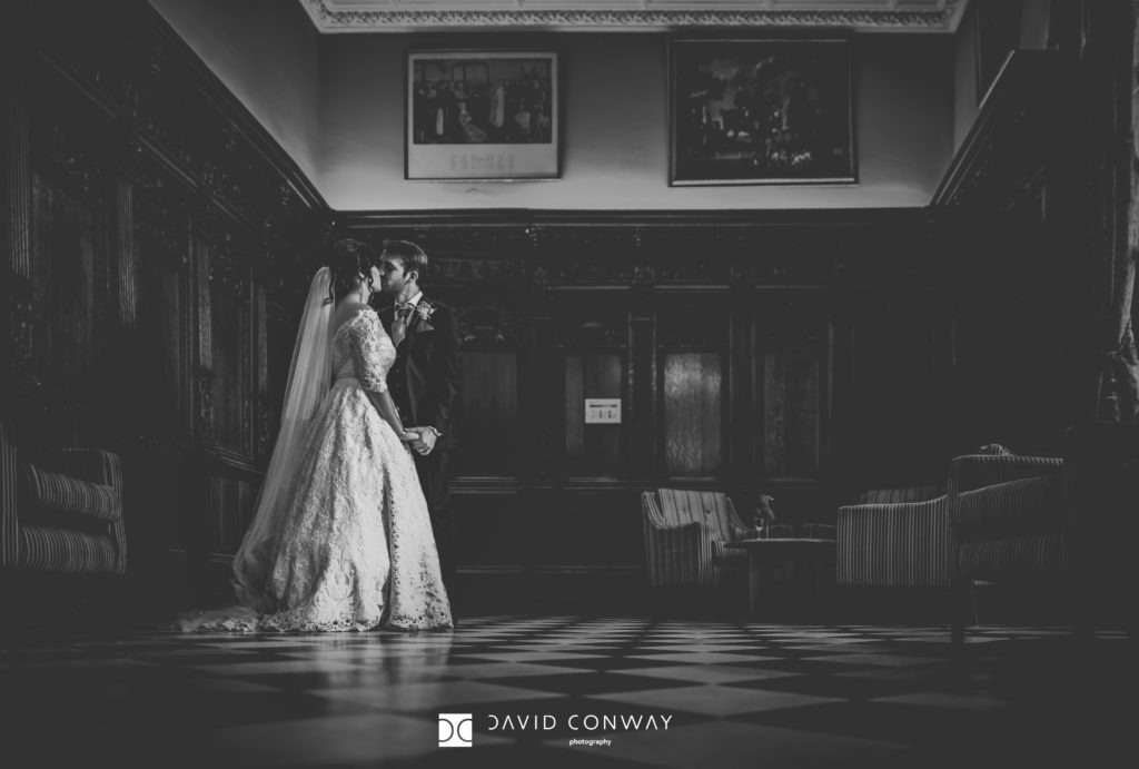 Bride and Groom in the reception hall at Hazlewood Castle near York, West Yorkshire