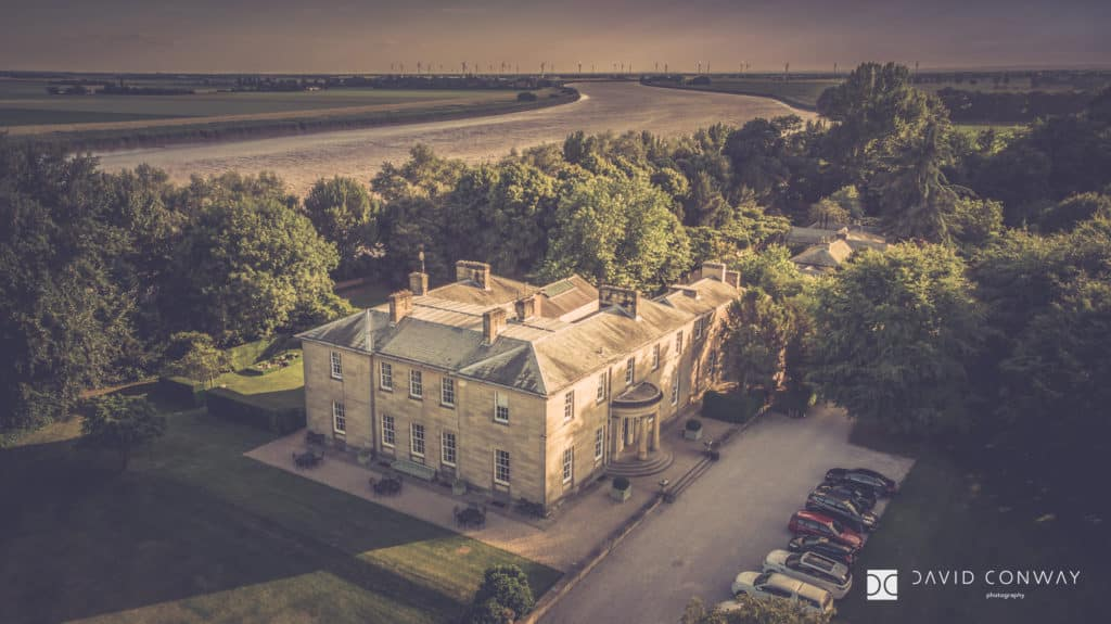 A drone shot of Saltmarshe hall with the river ouse in the background