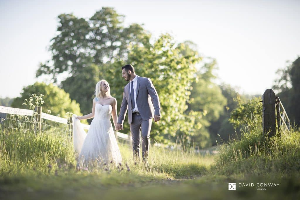 Bride and groom go for a romantic walk at Hazlewood Castle