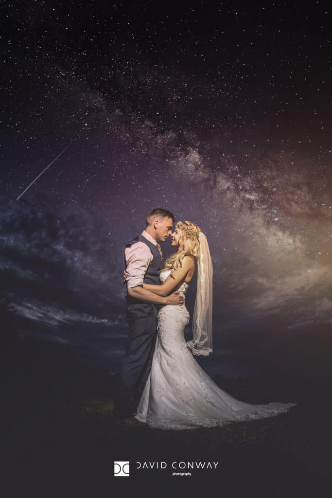 Romantic shot of bride and groom below the stars