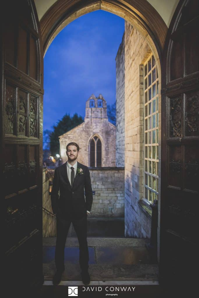 Groom in the doorway of Hazlewood Castle