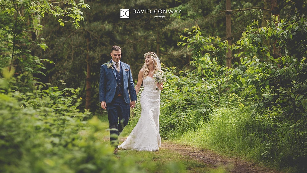 Bride and groom on romantic walk through the woods wedding photographer from West Yorkshire