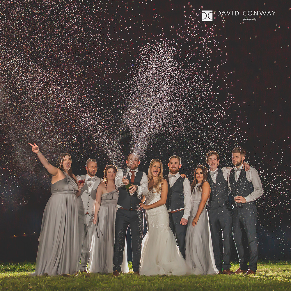 champagne-shot-of-bride-and-groom-with the-bridal-party